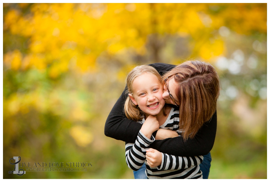 05-French-Park-Minneapolis-MN-Family-Fall-Photography-Mother-kisses-Daughter-on-cheek